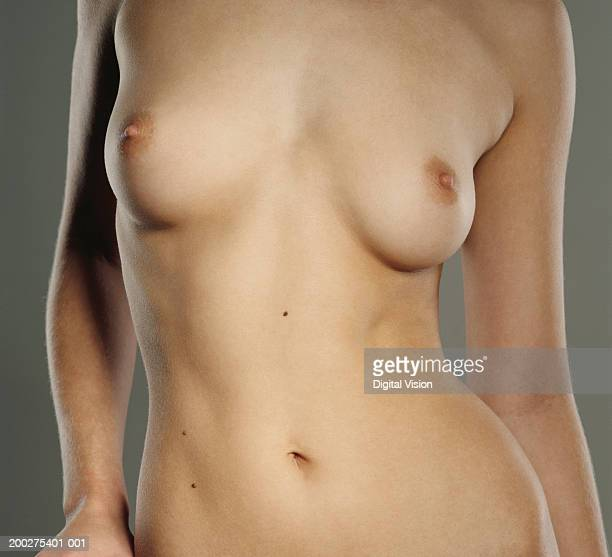Naked young woman, mid section, close-up