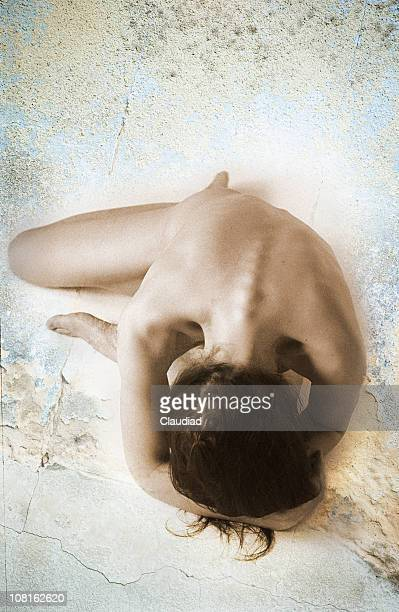 naked young woman posing against grunge background - old nudists stock pictures, royalty-free photos & images