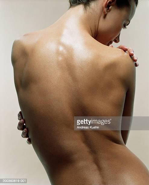 naked young woman, rear view - donna schiena nuda foto e immagini stock