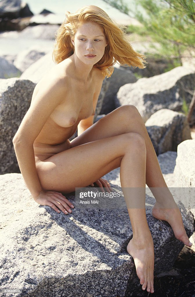 Naked Young Woman Sitting On A Rock Outdoors Stock Photo -7684