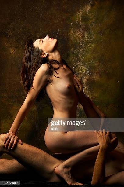 naked young woman sitting on man portraying sexual activity - göra bildbanksfoton och bilder
