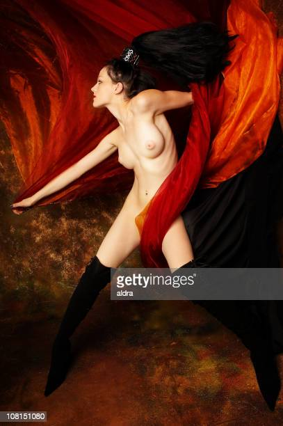 Naked Young Woman Wrapped in Orange Silk Fabric