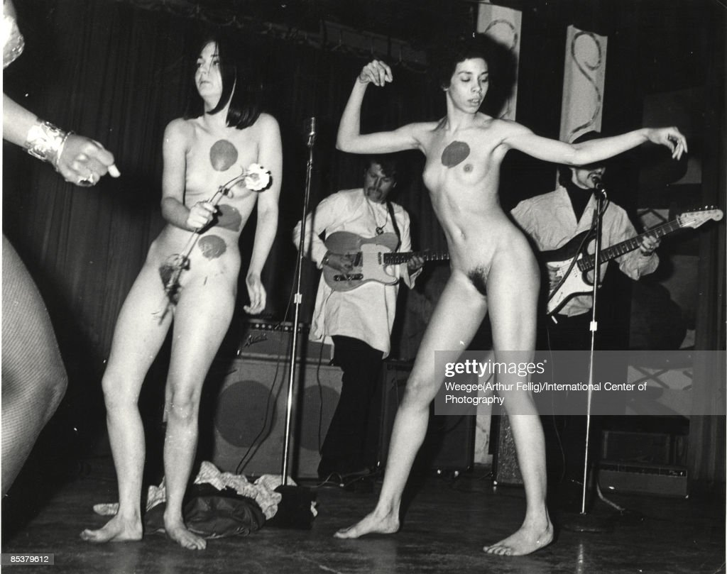 Naked young women, with dots painted on them, dance in front of a rock band, during a performance, a Body Festival, organized by artist Yayoi Kusama (born in Matsumoto City, Japan in 1929), New York, ca.1967. (Photo by Weegee(Arthur Fellig)/International Center of Photography/Getty Images)