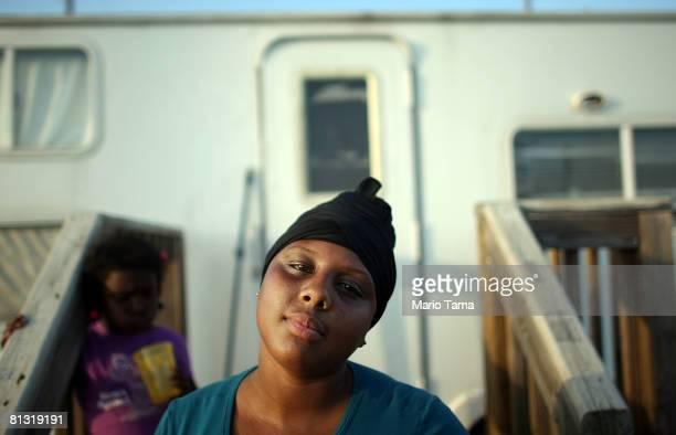Nakeva Narcisse and daughter Asanta Mackey sit outside their trailer in the FEMA Diamond trailer park May 31 2008 in Port Sulphur Louisiana Asanta...