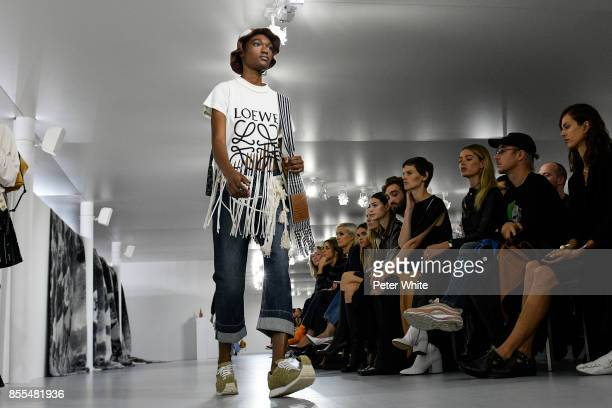 Naki Depass walks the runway during the Loewe show as part of the Paris Fashion Week Womenswear Spring/Summer 2018 on September 29 2017 in Paris...
