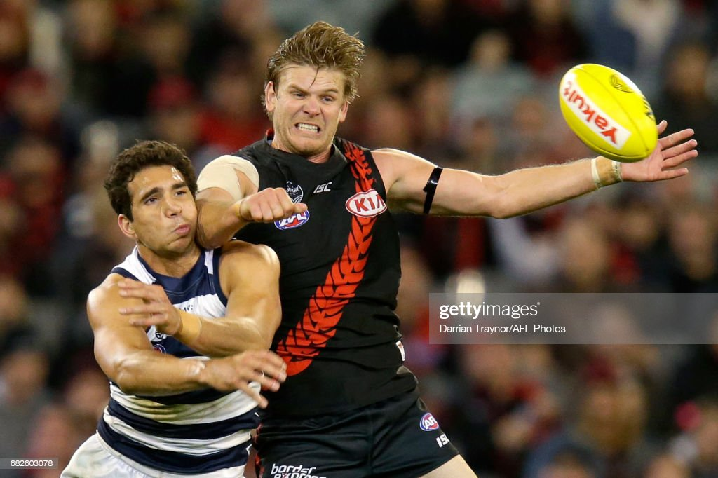 Nakia Cockatoo of the Cats and Michael Hurley of the Bombers compete for the ball during the round eight AFL match between the Essendon Bombers and the Geelong Cats at Melbourne Cricket Ground on May 13, 2017 in Melbourne, Australia.