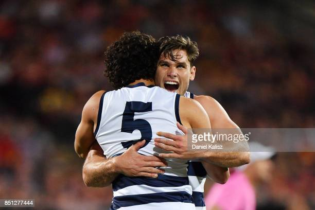 Nakia Cockatoo of the Cats celebrates with Tom Hawkins of the Cats after kicking a goal during the First AFL Preliminary Final match between the...
