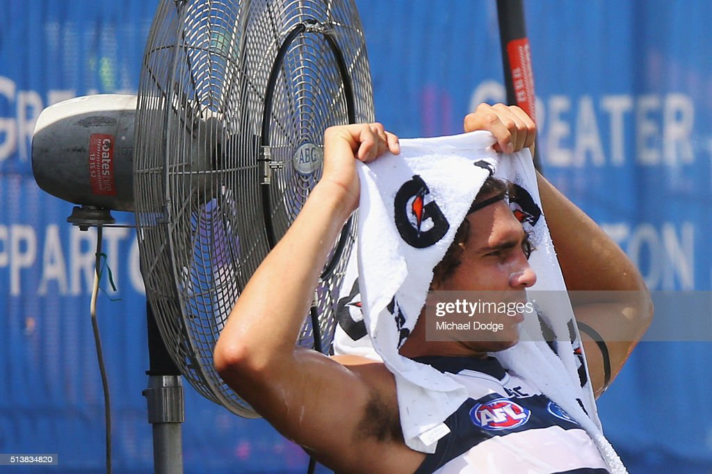 Nakia Cockatoo of the Cats cools off in the heat during the 2016 AFL NAB Challenge match between the Essendon Bombers and the Geelong Cats at Deakin Resserve on March 5, 2016 in Shepparton, Australia.