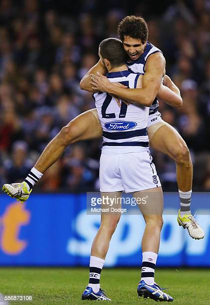 Nakia Cockatoo of the Cats jumps on Sam Menegola of the Cats after he kick a goal during the round 20 AFL match between the Geelong Cats and the...