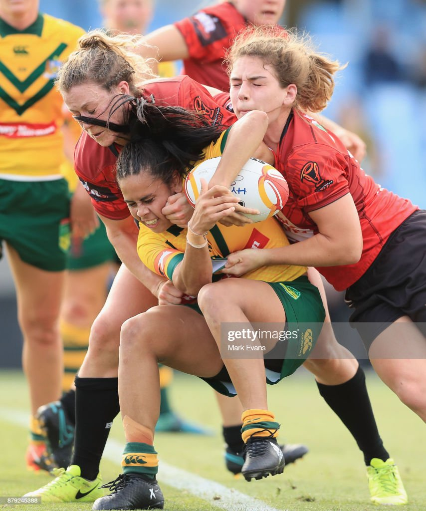 Nakia Davis-Welsh of Australia is tackled during the 2017 Rugby League World Cup Semi Final match between Australia and Canada at Southern Cross Group Stadium on November 26, 2017 in Sydney, Australia.