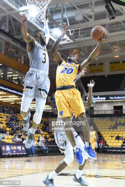 Nakye Sanders of the Towson Tigers takes a shot over Deshaun Morman of the Towson Tigers during a college basketball game at SECU Arena on January 11...