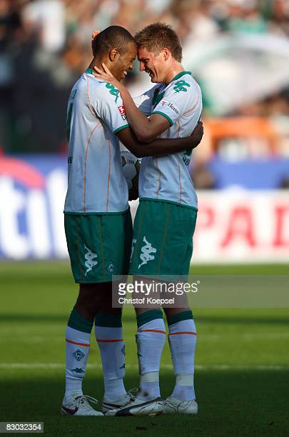 Naldo and Sebastian Proedl of Bremen celebrate the 54 victory after the Bundesliga match between Werder Bremen and 1899 Hoffenheim at the Weser...