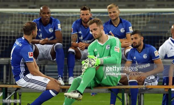 Naldo Benedikt Howedes Guido Burgstaller goalkeeper Ralf Fahrmann Johannes Geis and Daniel Caligiuri sitting together after the official squad photo...
