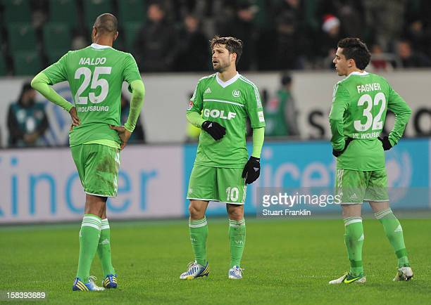 Naldo Diego and Fagner of Wolfsburg look dejected during the Bundesliga match between VfL Wolfsburg and Eintracht Frankfurt at Volkswagen Arena on...
