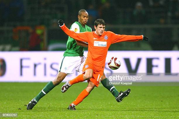Naldo of Bremen and Zlatko Junuzovic of Austria battle for the ball during the UEFA Europa League Group L match between Werder Bremen and Austria...