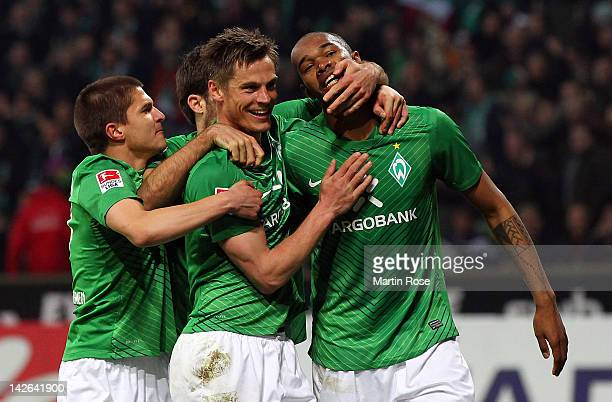 Naldo of Bremen celebrate with his team mates after he heads his team's equalizing goal during the Bundesliga match between SV Werder Bremen and...
