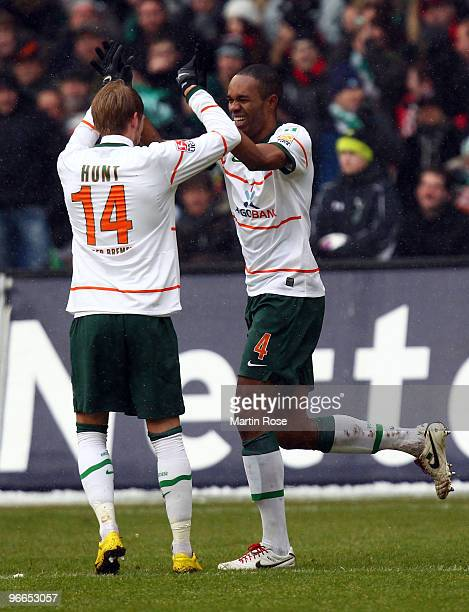 Naldo of Bremen celebrate with team mate Aaron Hunt after he scores his team's 2nd goal during the Bundesliga match between Hannover 96 and SV Werder...