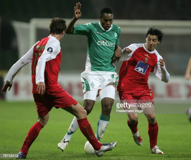 Naldo of Bremen fights for the ball with Pablo Contreras and Carlos Fernandes of Braga during the UEFA Cup round of 32 first leg match between Werder...