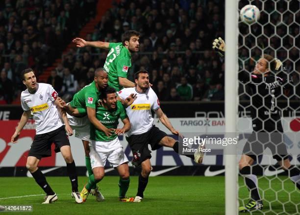Naldo of Bremen heads his team's equalizing goal during the Bundesliga match between SV Werder Bremen and Borussia Moenchengladbach at Weser Stadium...