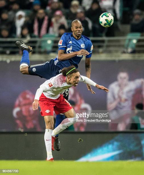 Naldo of FC Schalke 04 jumps for a header with Yussuf Poulsen of RB Leipzig during the Bundesliga match between RB Leipzig and FC Schalke 04 at Red...