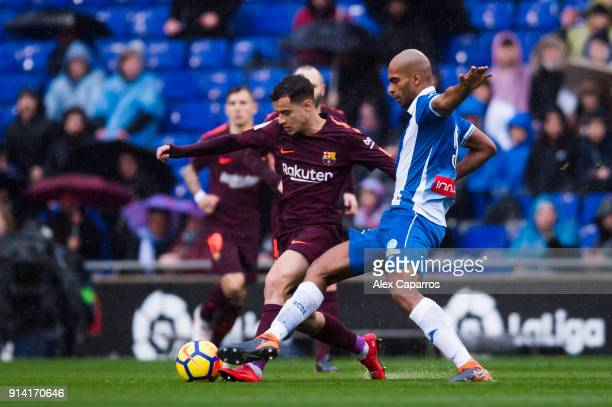 Naldo of RCD Espanyol tackles Philippe Coutinho of FC Barcelona during the La Liga match between Espanyol and Barcelona at RCDE Stadium on February 4...