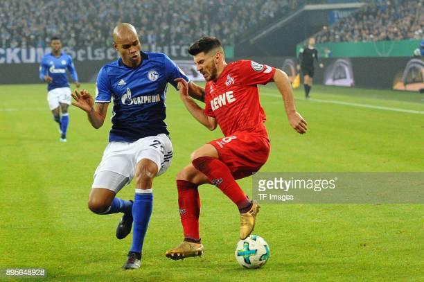 Naldo of Schalke and Milos Jojic of Koeln battle for the ball during the Bundesliga match between FC Schalke 04 and 1 FC Koeln at VeltinsArena on...