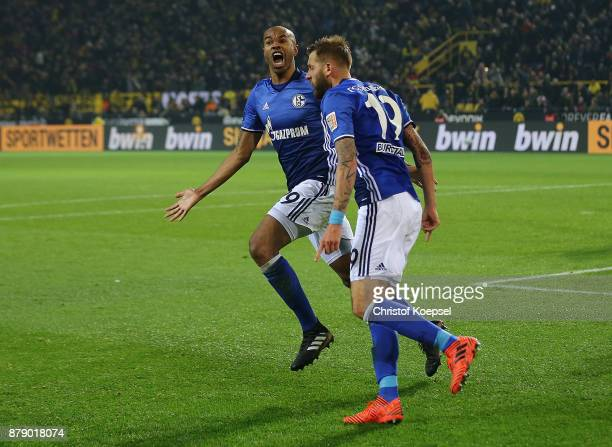 Naldo of Schalke celebrates after he scored a goal to make it 44 with Guido Burgstaller of Schalke during the Bundesliga match between Borussia...
