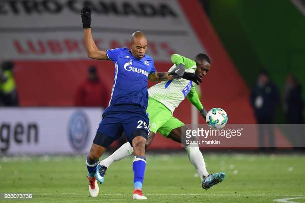 Naldo of Schalke fights for the ball with Landry Dimata of Wolfsburg during the Bundesliga match between VfL Wolfsburg and FC Schalke 04 at...