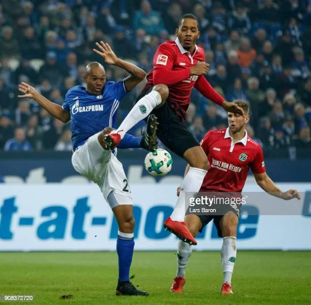 Naldo of Schalke is challenged by Charlison Benshop of Hannover during the Bundesliga match between FC Schalke 04 and Hannover 96 at VeltinsArena on...
