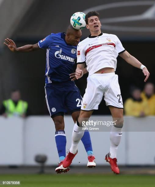 Naldo of Schalke jumps for a header with Mario Gomez of Stuttgart during the Bundesliga match between VfB Stuttgart and FC Schalke 04 at MercedesBenz...