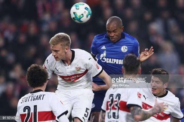 Naldo of Schalke jumps for a header with Timo Baumgartl of Stuttgart during the Bundesliga match between VfB Stuttgart and FC Schalke 04 at...