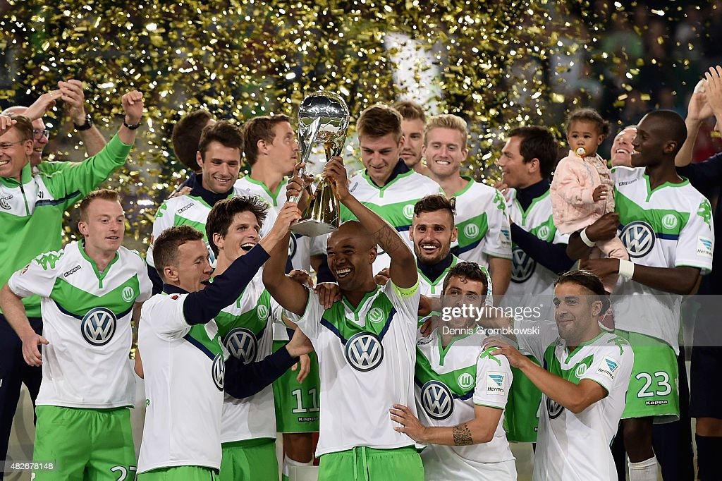 Naldo of VfL Wolfsburg lifts the trophy after the DFL Supercup 2015 match between VfL Wolfsburg and FC Bayern Muenchen at Volkswagen Arena on August 1, 2015 in Wolfsburg, Germany.