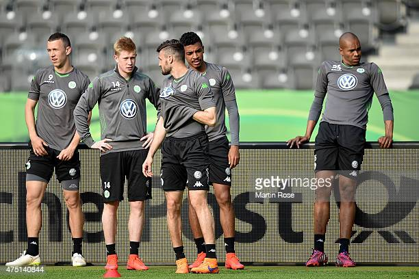 Naldo of VfL Wolfsburg looks unhappy whilst his team mates continue warming up during the DFB Cup Final 2015 training session at Olympiastadion on...