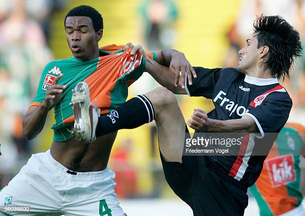 Naldo of Werder tussels for the ball with Chris of Frankfurt during the Bundesliga match between SV Werder Bremen and Eintracht Frankfurt at the...