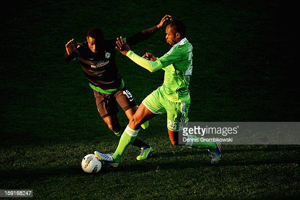 Naldo of Wolfsburg and Joseph Akpala of Werder Bremen battle for the ball during the friendly match between Werder Bremen and VfL Wolfsburg at Mardan...