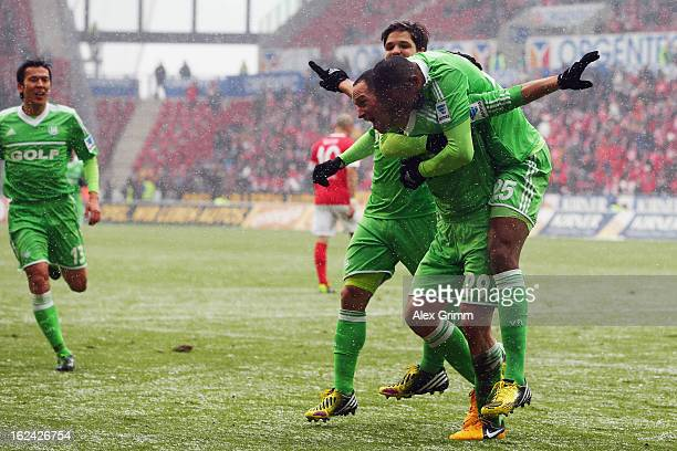 Naldo of Wolfsburg celebrates his team's first goal with team mate Jan Polak during the Bundesliga match between 1 FSV Mainz 05 and VfL Wolfsburg at...