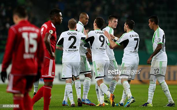 Naldo of Wolfsburg celebrates his teams first goal with team mates during the DFB Cup round of 16 match between VfL Wolfsburg and FC Ingolstadt at...