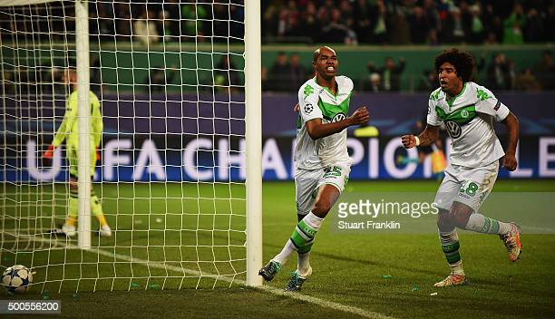 Naldo of Wolfsburg celebrates scoring the first goal with Dante during the UEFA Champions League match between VfL Wolfsburg and Manchester United FC...