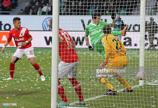 Naldo of Wolfsburg scores the first goal during the Bundesliga match between VFL Wolfsburg and FC Augsburg at Volkswagen Arena on February 2 2013 in...