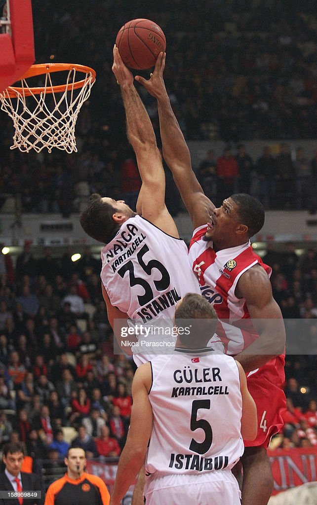 Nalga, #35 of Besiktas JK Istanbul competes with Kyle Hines,#4 of Olympiacos Piraeus during the 2012-2013 Turkish Airlines Euroleague Top 16 Date 2 between Olympiacos Piraeus v Besiktas JK Istanbul at Peace and Friendship Stadium on January 4, 2013 in Athens, Greece.