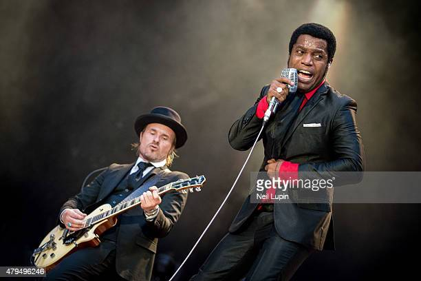 Nalle Colt and Ty Taylor of Vintage Trouble perform at Wembley Stadium on July 4 2015 in London United Kingdom