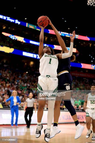 NaLyssa Smith of the Baylor Lady Bears has her shot blocked by Brianna Turner of the Notre Dame Fighting Irish during the fourth quarter in the...