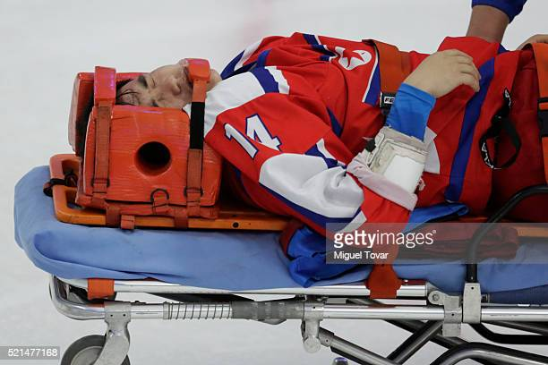 Nam Hyok Kim of Korea leaves the field injured during the match between Mexico and Korea as part of the 2016 IIHF Ice Hockey World Championship...
