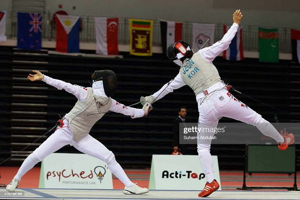 Nam Hyun Hee of South Korea (L) and Jeon Hee Sook of South Korea compete in the women's individual foil final during the 2015 Asian Fencing Championships at OCBC Arena on June 27, 2015 in Singapore.