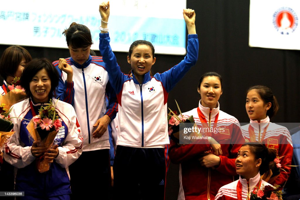 Nam Hyun Hee (C) of South Korea celebrates the win after the Women's Foil Team Tableau final on day four of the 2012 Asian Fencing Championships at Wakayama Big Wave on April 25, 2012 in Wakayama, Japan.