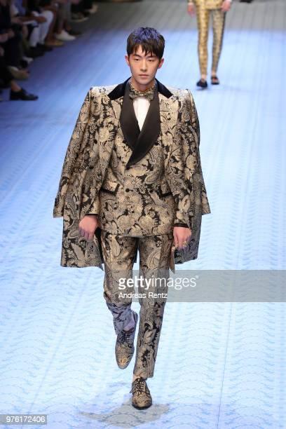 Nam Joohyuk walks the runway at the Dolce Gabbana show during Milan Men's Fashion Week Spring/Summer 2019 on June 16 2018 in Milan Italy