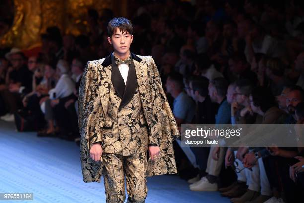 Nam Joohyuk walks the runway at the Dolce Gabbana show during Milan Men's Fashion Week Spring/Summer 2019 on June 16 2018 in Milan Italy