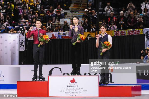 Nam Nguyen of Canada Yuzuru Hanyu of Japan and Keiji Tanaka of Japan receive their respective medals for placing during the ISU Grand Prix of Figure...