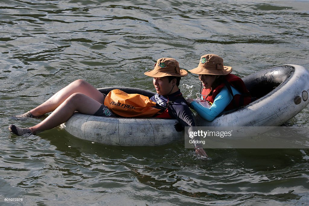 Tubing: activity of floating down on a large rubber tyre. : News Photo