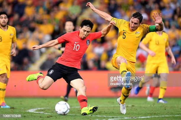 Nam Taehee of Korea Republic takes on the defence of Mark Milligan of Australia during the international friendly match between the Australian...